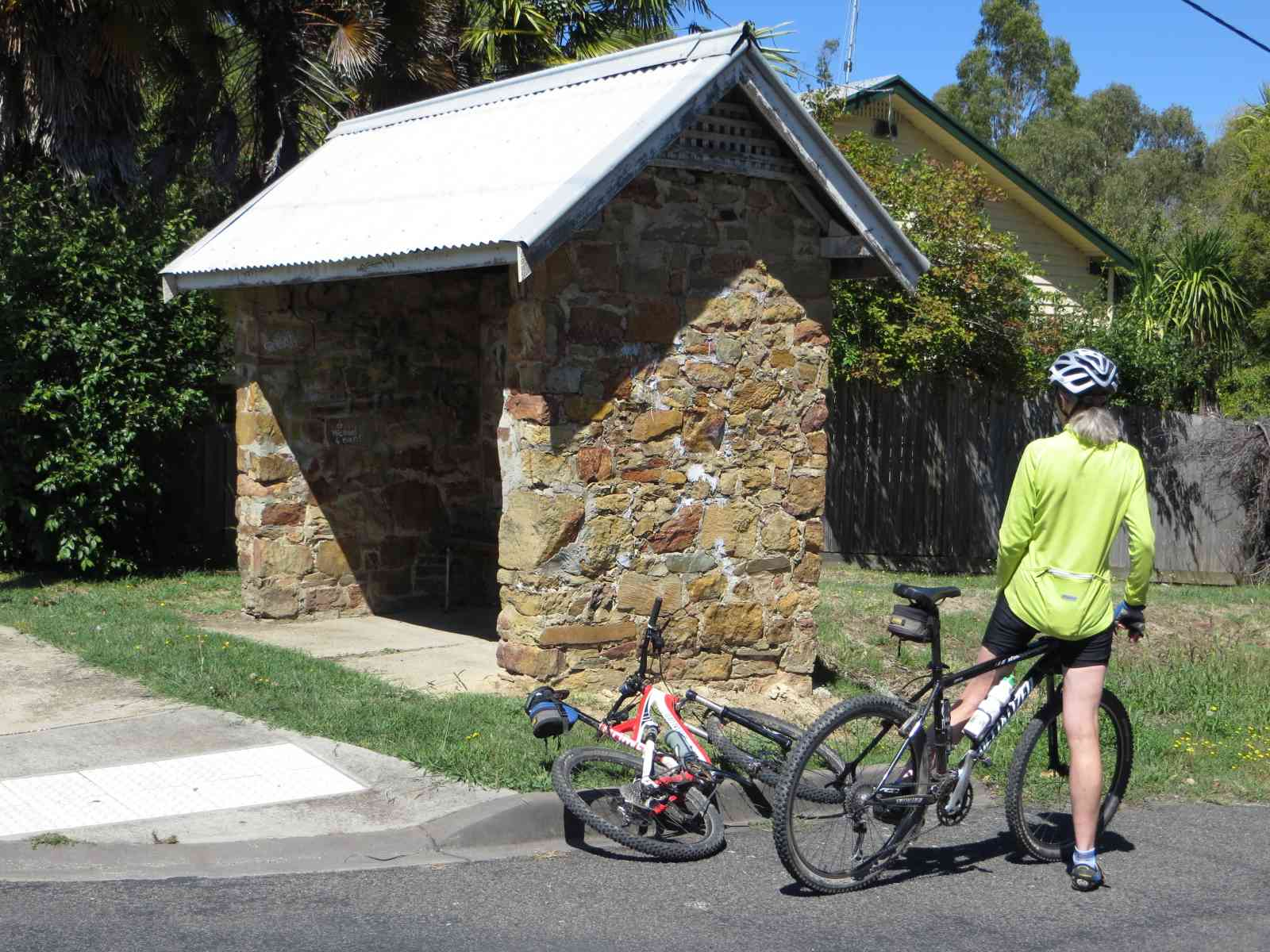 Stone bus shelter Fifth St